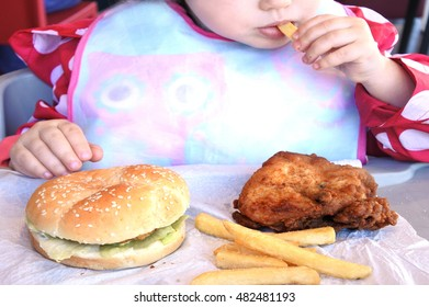 AUCKLAND - SEP 09 2016:Little Child (Naomi Ben-Ari age 2) eats fast food.Studies shows that over the past four decades, Fast foods especially among children and adolescents raised the risk of obesity