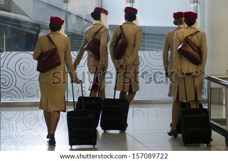 AUCKLAND - SEP 15:Emirates Airlines flight attendants in Auckland International Airport on Sep 15 2013.Emirates Airline was voted Airline of the Year in 2013.
