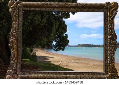 Auckland,New Zealand - Jan, 2019: Beautiful landscape view can seen through the antique golden picture frame which is located at the Mahurangi Regional Park in Auckland in north island of New Zealand
