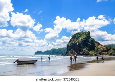 Auckland,New Zealand - March 3,2016 : People can seen exploring and relaxing around Piha beach,which is located at the West Coast in Auckland,New Zealand.