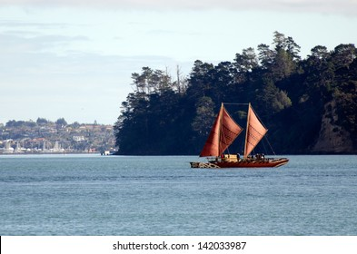 AUCKLAND,NZ - JUNE 02 2013:Te Aurere (Maori double-hull canoe) sailing in Auckland Waitemata Harbour. Built in 1991-2 to help revive the Maori culture of ocean sailing it has sailed 30,000 NM.