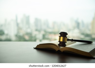 auction hammer or judge gavel with law books on legal desk with copy space.