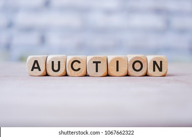 AUCTION word written on wood block