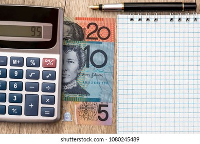 AUD  Australian dollar with calculator, notebook pen