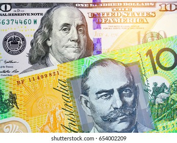 AUD and US dollar bank notes concept business background. Close up view of US Dollar and AUD bills. currency exchange rate. Background with money american dollar and australian dollar baht banknote