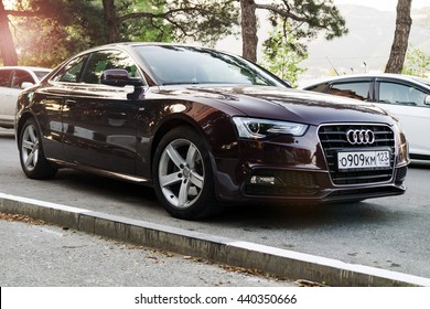 Audi A5 in sunlight Munich, GERMANY - APRIL 29, 2016: A Audi A5 parked on the streets of Munich. Audi is among the best-selling luxury automobiles in the world.