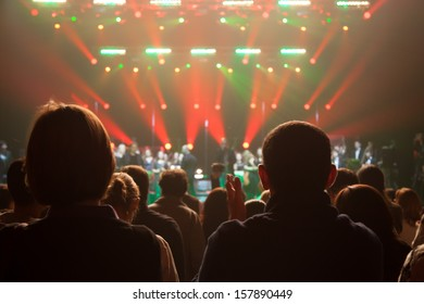 The audience applauded the artists on stage.