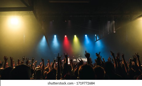 Audience and colorful lights at concert