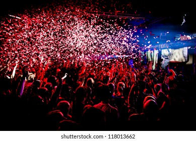 Audience Crowd Silhouette Confetti Explosion While Dancing to DJ Pete Tong at Cream Nightclub Party. Nightlife Lazer Show Hands In Air with Confetti