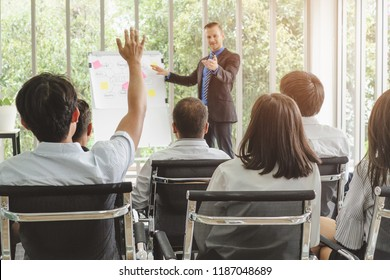 Audience having a question during meeting conference.