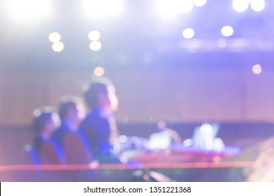 Audience is listening  the speakers on the stage in the conference hall or seminar meeting, business and education concept