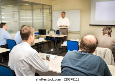 The audience listens to the acting in a computer classroom