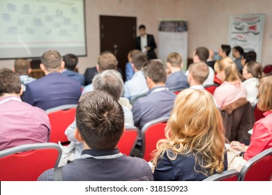 The audience listens to the acting in a conference hall. Seminar, Classroom, Adult.
