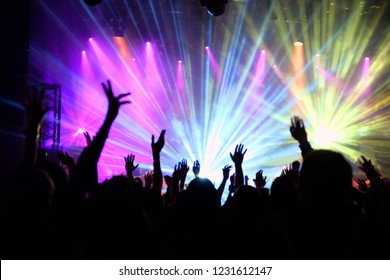The audience raised hands at a concert in rock club