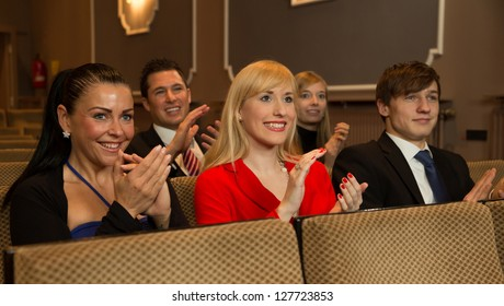 Audience in a theater, on a concert or in a cinema clapping and applauding