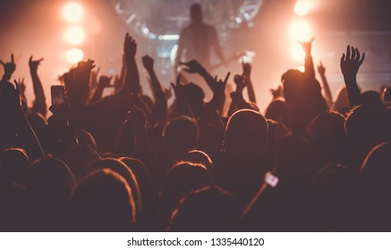 The audience with their hands on a rock concert
