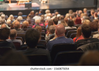 audience watching play at the theater