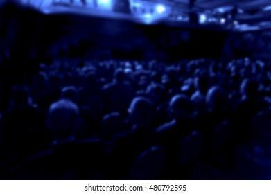 audience watching theater play blurred