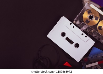Audio Cassette Compact Tape on Black Background. Photo in Retro Style. Toned image.
