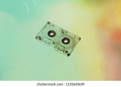 Audio cassette on background wallpaper textures retro old vintage melody nostalgia modern time 70s 80s 90s generation song sound top hits music texture colorful paint listen.