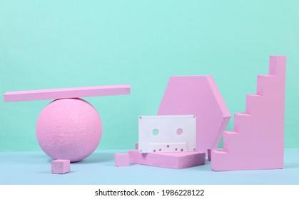 Audio cassette with pink geometric shapas on blue background. Concept art. Minimalism