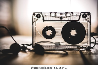 audio cassette tape with headphones lying on the table