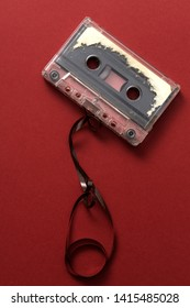 Audio cassette tape on red backgound, from above