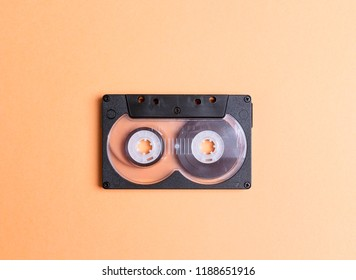 Audio cassette tape on a yellow background. Nostalgia concept.