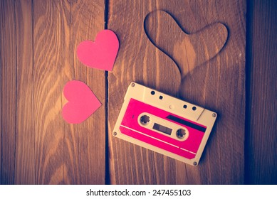 Audio cassette tape in the shape of heart. Retouching vintage.