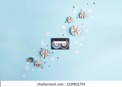 Audio cassette tape with winter cones and snowflakes. Holiday music for winter mood. Nostalgia concept. Place for song title.