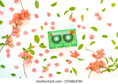 Audio cassette top view flat lay springtime floral decoration for 1970s, 1980s and 1990s music retro revival concept