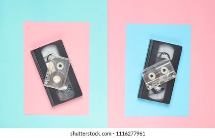 Audio cassette, video cassette on a pink pastel blue background. Retro attributes from the 80s. Top View