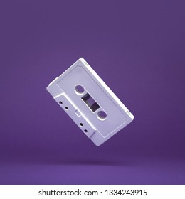 Audio cassette. Vintage white audio cassette tap on colored background. Old cassette tape audio isolated on white.