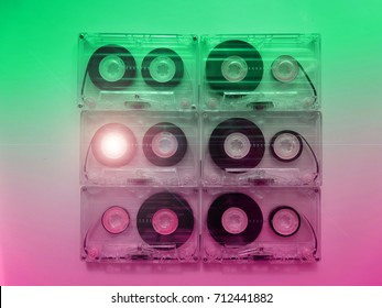 Audio cassettes for recorder 80s 90s 70s retro vintage old music time generation music tape wallpaper background style nostalgia song neon cover
