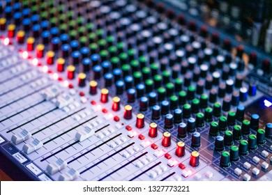 Audio control panel in the audiovisual control room at dark tone.
