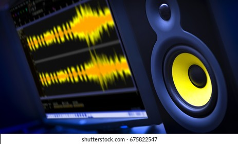 Audio Editing Computer with studio monitor speaker and waveform displayed on monitor.  Shallow Depth of Field with focus on speaker.