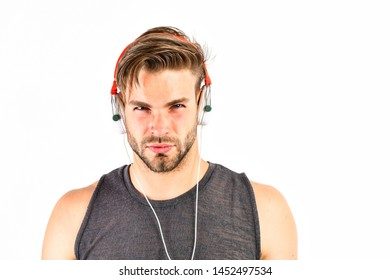 Audio education. Listen music for motivation and inspiration. Audio quality. Audio track. Man handsome unshaven hipster listening audio file using headphones gadget. Modern earphones concept.