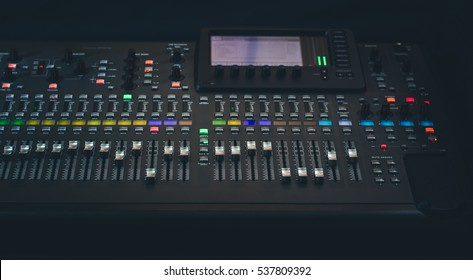 The audio equipment, control panel of digital studio mixer, front view. Close-up, selected focus