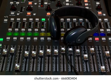 The audio equipment, control panel of digital studio mixer and headphones, close-up.