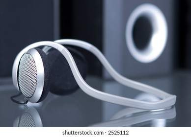 Audio head phones with speakers at the background