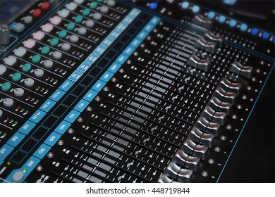 Audio mixer console with light shading in control room