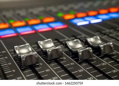 Audio Mixer with Faders pushed up on a Yamaha Mixer