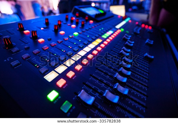 Audio mixer and microphone. Close-up of the Mixing console. mixing knobs.