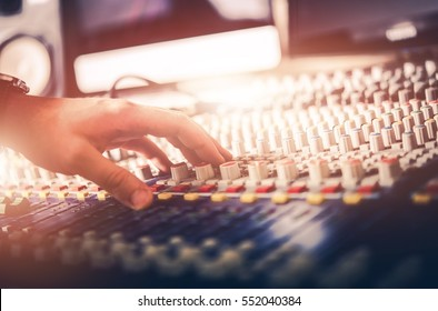 Audio Mixer Sound Adjusting Closeup Photo. Professional Sound Mixer Operator.