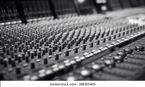 Audio Mixing Board,Professional audio mixing console with faders and adjusting knobs,TV equipment Black and White, selective focus