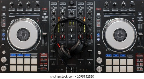 Audio mixing controller with professional headphones. DJ tools. Top view