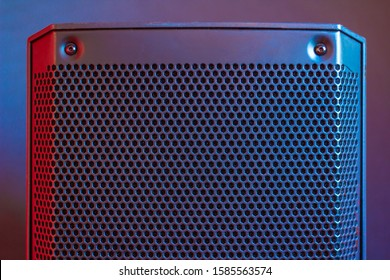 audio PA speaker illuminated by colorful light front view, top of cabinet, symmetry