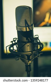 Audio recording vocal studio voice microphone with anti shock mount and built in anti pop filter for singing and voiceover actors doing voiceovers.