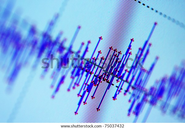 Audio, seismic or stock market wave diagram. Macro closeup, shallow DOF.