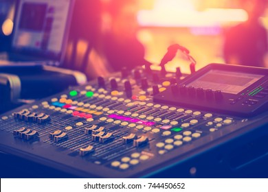 Audio Sound Mixer Adjusting Professional Sound Engineer Operator in Concert Hall